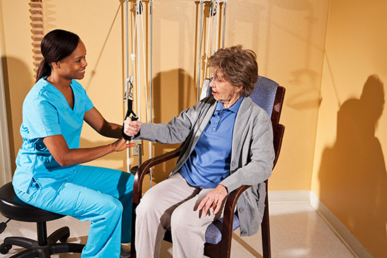 nurse with patient working on physical rehab
