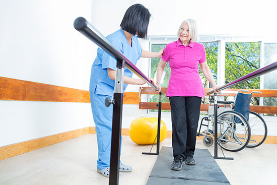 nurse and women working on physical therapy, walking